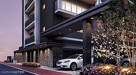 重厚感を演出するパーキングゲート。建物と連続性を持たせるファサードデザインにより敷地の独立性を高めます。