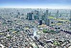現地周辺航空写真(2016年4月撮影) ※一部CG加工を施したもので実際とは異なります。光は現地の位置を示したもので建物の高さを表現するものではありません。