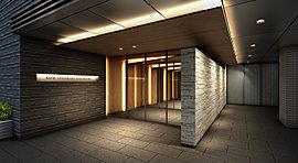 """光の導きと、温かみのある素材感で迎える、心を解くエントランス空間へ。過去から続く一筋の光が未来を紡ぎ出すように。「編み」「重なり」「光と陰影」というデザイン要素で""""織りなすデザイン""""を追求する。"""
