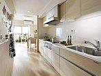 作業スペースをたっぷり確保した機能的なI型キッチン。通路幅もゆとりがあり、ゆったりと料理を楽しめます。
