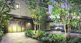 緑豊かなプライベートアプローチ、その先に構える重厚かつモダンな邸宅。美しいエントランスアプローチに誘われ一歩中へ、潤いの緑がアーチとなって、住まいへと優しく迎え入れます。