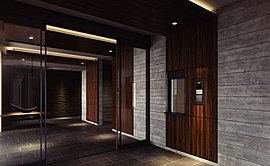 木目のやさしさを、迎賓の文様として。エントランスホールには、それぞれに風合いが異なる天然木の突板を、迎賓のアートとしてしつらえました。思わず触れたくなる手触り感や温もりに癒され、オンからオフへと心が解き放たれる空間です。