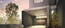 上品な白いタイルの床が、アプローチから建物内部までつながるエントランス。