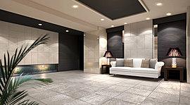 ダイナミックに市松貼りを施した壁面の大判タイルが目を引くエントランスホール。ブラックの木目調の壁面タイルや、上品なグレーの風合いのある床タイルが相まって、格調高い迎賓の空間を演出します。