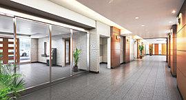 ブラウン系にまとめた壁面のデザインパネルと折上天井からの間接照明による演出、そしてフロアに広がる落ち着いた色合いのテクスチャーの相乗効果によって、すっきりとした中にも気品を感じさせる空間へ。