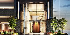 都心のメインストリートにやさしさを。風合いのあるタイルや木製のルーバー、そして豊かな緑で、重厚感のあるデザインに人のぬくもりを感じさせる。それは、オフィスが並ぶエリアにあって、オアシスのようにあたたかな存在感を放つ。