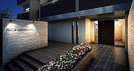 プロローグ空間においては、アプローチの中央に花壇のような植栽スペースを設け、壁面には素材感のあるマテリアルを貼り詰めることで、普遍的な美をもたらしています。