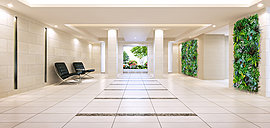 明るさと清潔感に満ちたエントランスホール。館内へと導かれ一歩足を踏み入れると、そこは、空間全体をホワイトで統一したスタイリッシュなエントランスホール。