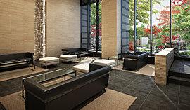 空間全体に高級ホテルの上質感と優雅さを演出したのが、2層吹き抜けの「ガーデンラウンジ」。約300mmの段差を設けることで、外部の水景の水面と目線のラインが合わさり、大きなカーテンウォールとあいまって内部とアプローチをつなぐ空間デザインを追求