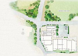 隣接する公園の緑からつながるエントランスへのアプローチは、帰り着いた居住者をやさしく迎えます。