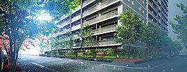 心地よい陰影をつくる木調ルーバーで連続性をもたせた南面ファサード。足元を彩る「四季の小径」には、防犯の役目を担うヒイラギモクセイや幹肌が美しいシャラを植樹しました。