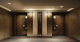 安らぎと重厚感に包まれる、この住まいを象徴する空間。静けさに満ちた内廊下は、私邸に持つ上質な時間を予感させます。木調の壁面と貼り分けられたカーペットが、やわらかなコントラストを生み、品位の高さを物語ります。