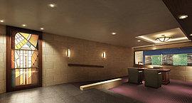 コンシェルジュ・デスクを設けたエントランスホールには、ステンドグラスの幻想的なオブジェ。