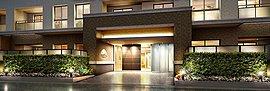 建物基壇部には城郭建築を彷彿とさせる格調高いエントランスをデザイン。街並みとの親和性に配慮して花壇と生け垣を設えたナチュラルな囲障により、沿道からの視線を緩和し邸宅としての安心感を高めています。