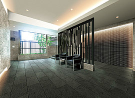 レジデンスの顔となる空間にふさわしい上質なマテリアルで演出したエントランスホール。ガラスウォールから植栽の緑と光を招き入れる趣向です。