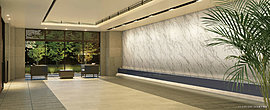 お帰りになったご家族を静穏な空気でつつむ洗練されたエントランスホール。スポットライトが効果的に印象づける壁面デザインや間接照明の光を広げる折上天井、多彩な素材が生む優れた質感など迎賓の空間にふさわしい意匠です。