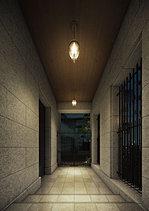 家族が待つプライベートな空間へ誘うコリドー。エントランスホールを抜けると、コリドー(回廊)が住居棟へと誘います。天井を木目調としたコリドーは、ペンダント照明のやわらかな明かりと相まり、落ち着きとぬくもりのあるスペースに。