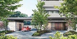 シンポルツリーを配したアプローチと車寄せに設けられたキャノピーは、邸宅としての重厚感を備え、風格ある佇まいを演出します。