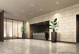 シックな色調で統一された床や壁面のタイル、外光をとりいれる大型の開口部や間接照明のライティングなど、光のデザインによって柔らかなおもてなしの雰囲気を醸成するエントランスホール。足を踏み入れると、カウンターでコンシェルジュがお出迎え。