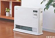 高効率給湯暖房器で暖房と給湯を行う先進のシステム。マイルドでクリーンな暖房が特徴の温水ルームヒーターをリビングに設置しました。