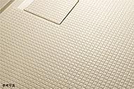 特殊加工により水たまりができにくく、乾きやすい「カラリ床」。足下が滑りにくく、カビを抑える効果もあります。