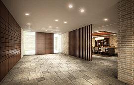 ラウンジ壁には天然石やボーダータイルを貼り分け、床面は一部のタイルをフローリング調とするなど、共用空間の壁面や床素材は、自然な風合いを醸し、それぞれの素材が融合し上質な空間を創出します。