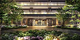 風格と優雅さに満ちた出会いの空間。開放的で植栽豊かなエントランスアプローチは、両サイドに重厚な石積み風仕上げを施して風格を演出。