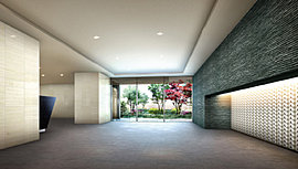 伸びやかなエントランスホールは大理石調タイルや石貼り、折上天井などを採用し、窓外に緑景も望めるようにすることで、心地よくて格調高い歓待の場に仕上げました。