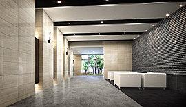現代的な感性でデザインされたエントランスホール。大判タイルなどの上質なマテリアルと、コントラストが鮮やかな色調の切り替えにより、現代的なテイストを与えたエントランスホール。ご歓談いただけるソファをご用意し、植栽を眺める開口部も設けました。