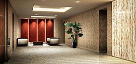 自然素材を活かした光パネルが印象的なエントランスホール。質感豊かな石材を壁面や床面に丁寧に貼り分け、洗練されながらも、温もりを感じることのできるデザインに仕上げました。