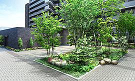 エントランスホールは開放感と上昇感を演出した2層吹き抜けの贅沢な空間に。天井まで伸びる木調のデザインウォールと、外の緑景をアートのように楽しむことができる大きな開口部をしつらえ、ここに暮らす歓びを日々感じていただける美しい意匠としています。