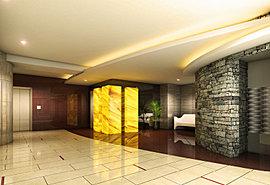 艶やかなタイルを敷き詰めた床、自然な重厚感を演出する石積み仕上げの壁面、そして上質感を与えるアクセントとしての光壁とアーティスティックな天井デザイン。すべてが一体となって人を優雅な気分でお迎えする、格調とあたたかみに満ちたエントランスホール