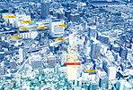 都市機能の中枢と居住エリアの境界に建つ