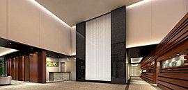 タワーの中に一歩足を踏み入れれば、二層吹抜けのエントランスホールに大きく飾られたアクセントウォールが迎える。