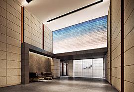 美術館やホテルを彷彿とさせる、天井高約4.9m・二層吹抜けの贅を尽くした空間。「公」から「私」へ、自然と気持ちが切り替わっていくように、自然石を基本にした壁や、素材感を活かした床、柔らかな空間を演出する間接照明を配しています。