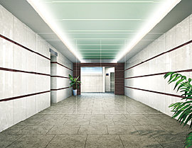スタイリッシュなエントランスホールは、光沢のある白い壁面にアースカラーのシャープなラインをあしらい、素材の持つ上品な美しさを投影させました。