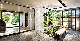 パブリックとプライベートを繋ぐ中間領域となるエントランスホールには、床を掘り下げた植栽スペースを設けました。
