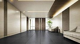 住まう方、訪れる方を迎えるエントランスホールは、床面に外からの連続性を持たせた600角のグレー色磁器質タイルと、木目調と自然石風のテクスチャーのデザインによって、あたたかさと気品を感じさせる迎賓空間へとまとめました。