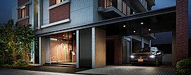 都会的なコンクリート打ち放しに暖かみのあるレンガ調のタイルをアクセントとし、周辺の街並にひときわ際立つ迎賓空間です。