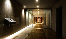 エントランスの壁と床には石調タイルを採用。