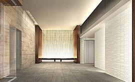 間接照明の優しい光の中、静けさと安らぎが漂うエントランスホール。正面には木立をイメージした和紙による光壁が美しく迎えます。動線をクランクにすることで場面展開を演出し、ギャラリーのような趣きを目指した空間です。