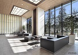 大きなガラスウォールを採用し、瑞々しい植栽の眺めと光あふれる寛ぎの場をデザインしたグランドロビー。夜間も壁や天井からやわらかな光が降りそそぎ、いつでもソファーに腰かけて語らいのひとときを過ごせるスペースです。