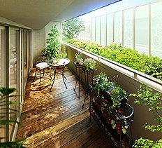 1階住戸のバルコニーの前には季節を感じる植栽帯と光を透過する乳白色のFRP板を設置し、外部からの視線を遮りながら充分な採光も確保。プライバシー性に配慮した、明るく広々とした空間です。