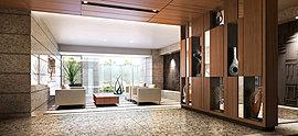 並木道の光を感じながら、豊かな時間が流れるラウンジ。南からの明るい陽光を受けるように、ホールから一段下がった位置に寛げるラウンジを計画しています。壁面のデザインウォールや印象的なタイルの床が、上質な雰囲気を演出。