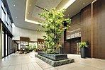 床や壁の素材が品格を感じさせる「フロントエントランス」。水盤からの心地よい水音、色鮮やかなグリーンがプライベートな日常へと導いてくれます。
