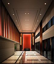 2階のグランドエントランスは、気品とホスピタリティにあふれる空間。2層吹き抜けの開放感と、織物をあしらったアートウォールが訪れる方を優雅にお迎えします。