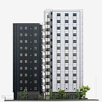 建物の基調となる白系色と黒系色のタイル。この2色をコーナー部で貼り分けることで、色合いのコントラストをより明確にしています。