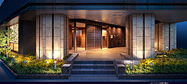 新しい和の創造を提案するエントランスラウンジ。日本の伝統的な意匠である格子状のデザインを大胆に採り入れながらも、存在感あふれるチェアや、あたたかみに満ちた間接照明などが響き合うことで、新しい和の創造を目指した意匠。