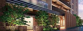 エントランスホールに隣接して、住まう方々の交流の場となるラウンジを設置。壁や床にタイルや木彫シートを採用し、落ち着いた寛ぎの雰囲気を演出。柔らかく隔てられた2つの空間をデザインし、複数の方が同時に利用しやすいよう配慮しました。