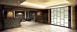 くつろぎと上質さを兼ね備えたグランドエントランスホール。和紙素材を用いた壁面を艶やかに照らす間接照明は、そのやさしい灯りがおもてなしの想いを演出します。